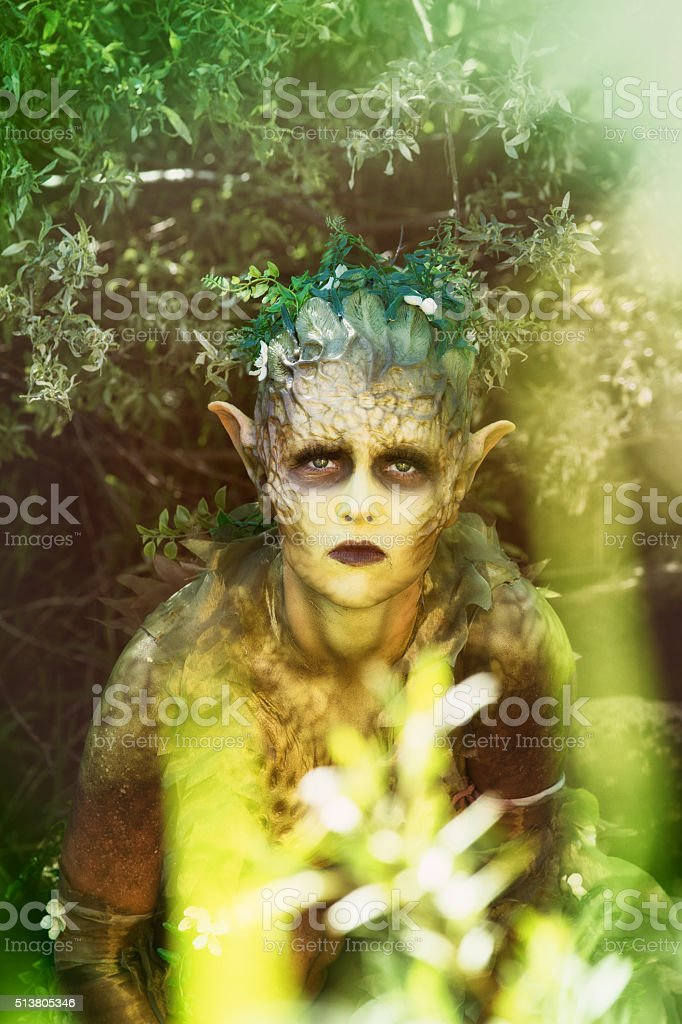 Sad distressed nature nymph looking pleadingly at camera stock photo