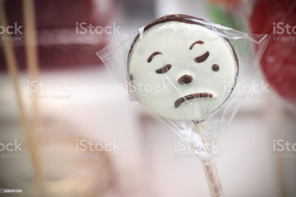 Sad Face Harlequin Clown Lollipop stock photo