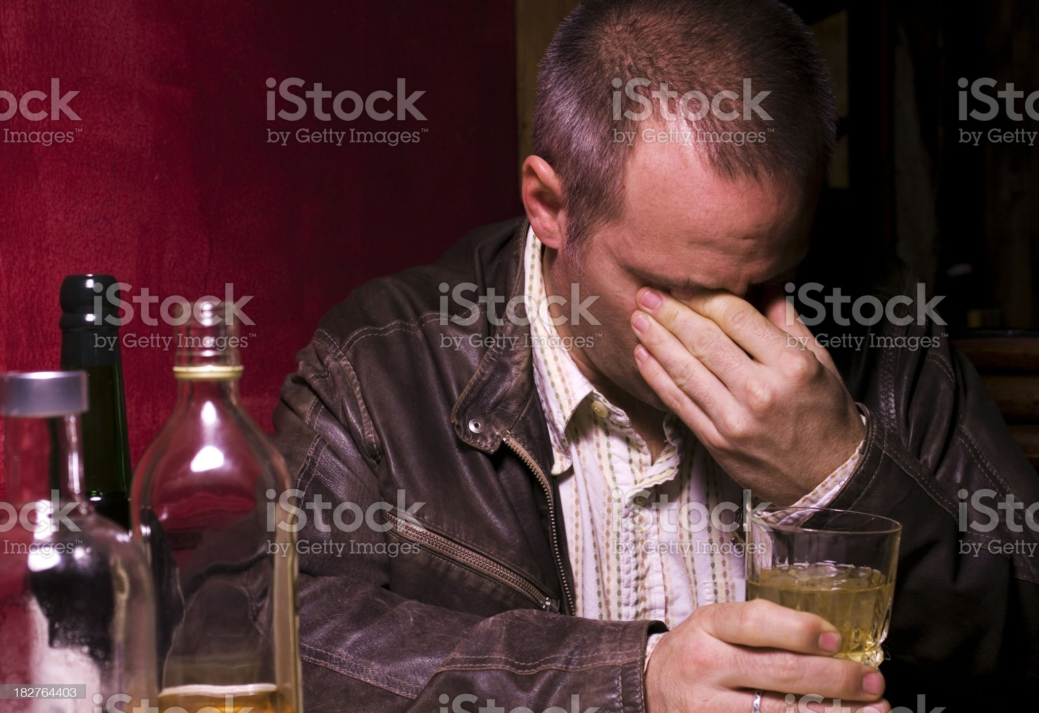 Sad Forty Year Old Man Drinking and Crying royalty-free stock photo