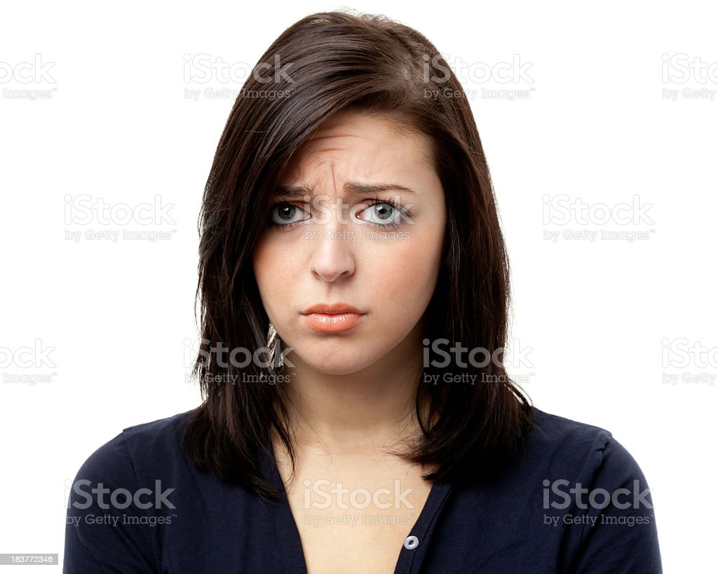 Sad Frowning Young Woman Looking At Camera stock photo