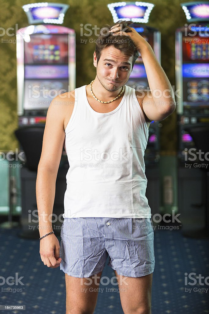 Sad Gambler After Losing Everything at Casino royalty-free stock photo