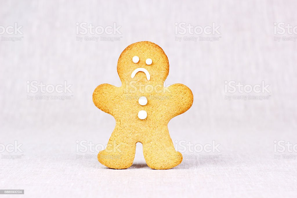 Sad Gingerbread Man frowning stock photo