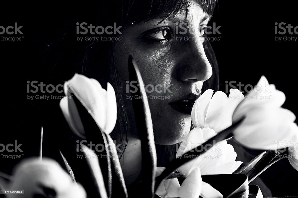 Sad girl behind a tulip bouquet royalty-free stock photo