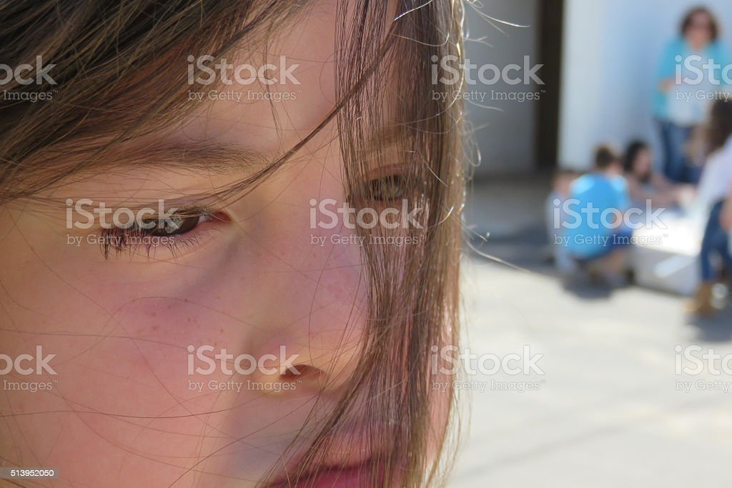 Sad girl boycotted by friends stock photo