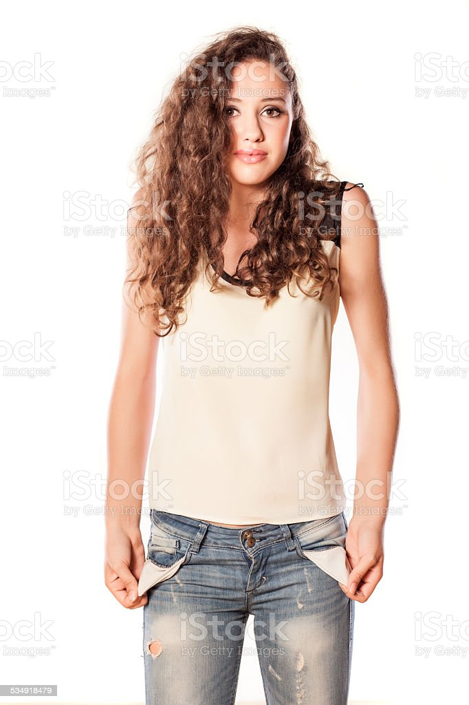 Sad girl holding her pockets turned inside out stock photo