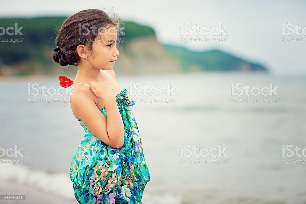Sad girl on the beach stock photo