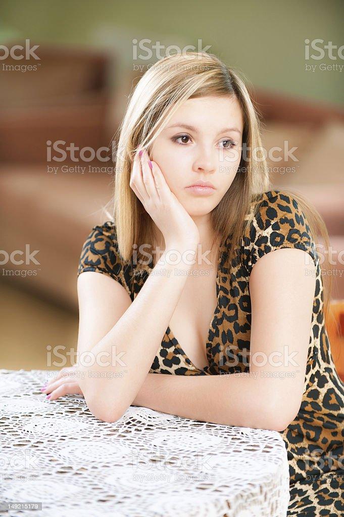 Sad girl sits at table royalty-free stock photo