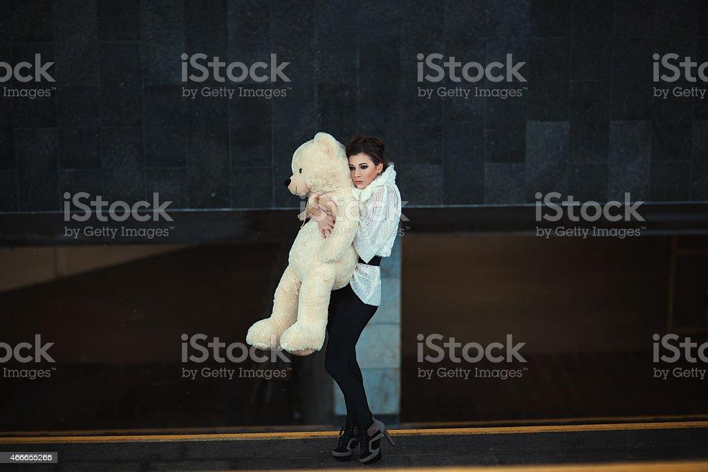 Sad girl with a bear. stock photo