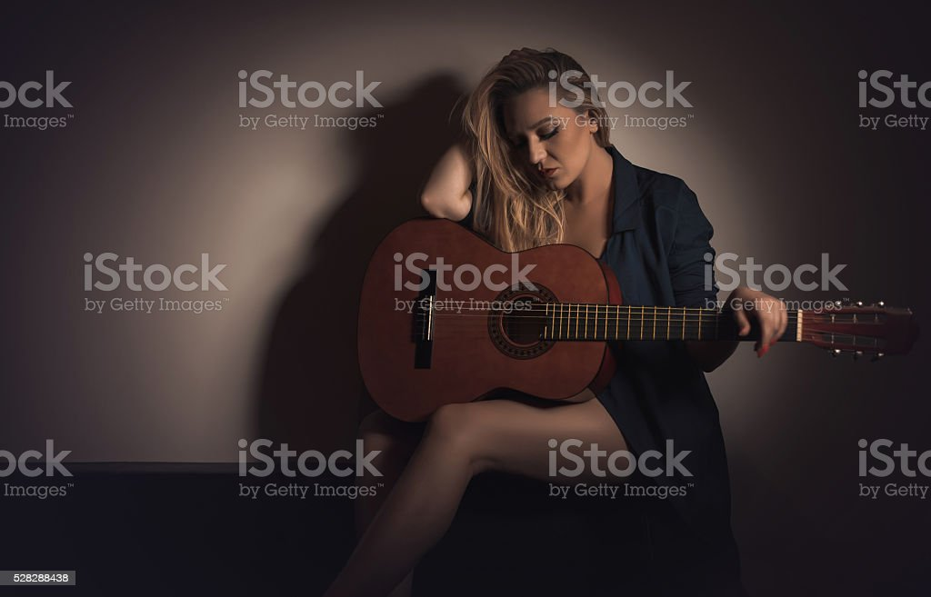 Sad girl with guitar stock photo