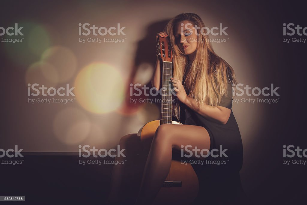 Sad girl with guitar stock photo