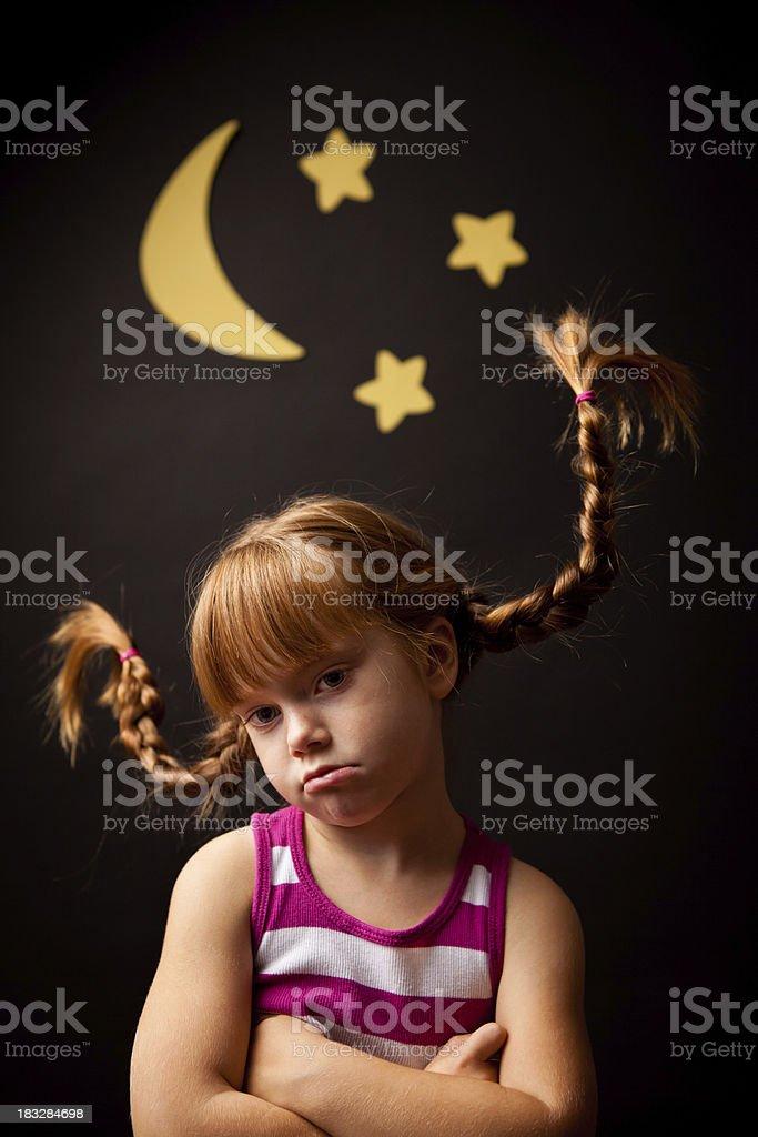 Sad Girl with Upward Braids Standing Under Moon and Stars stock photo