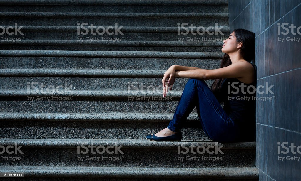 Sad hispanic woman stock photo