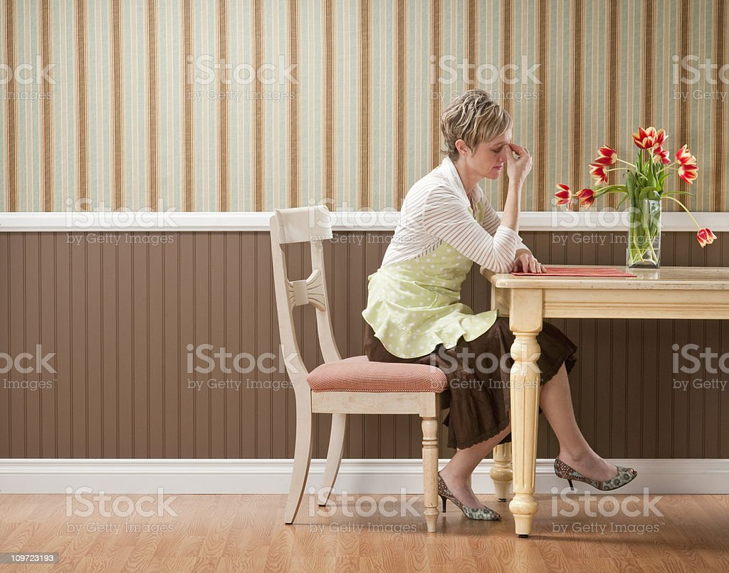 Sad Housewife At Dining Table royalty-free stock photo