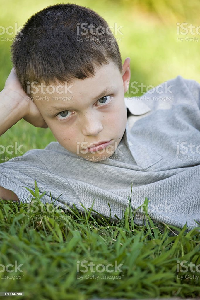 Sad in the Grass royalty-free stock photo
