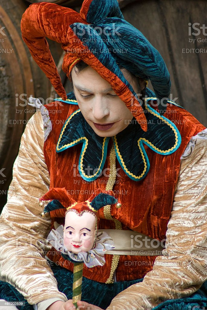 Sad jester with puppet stock photo
