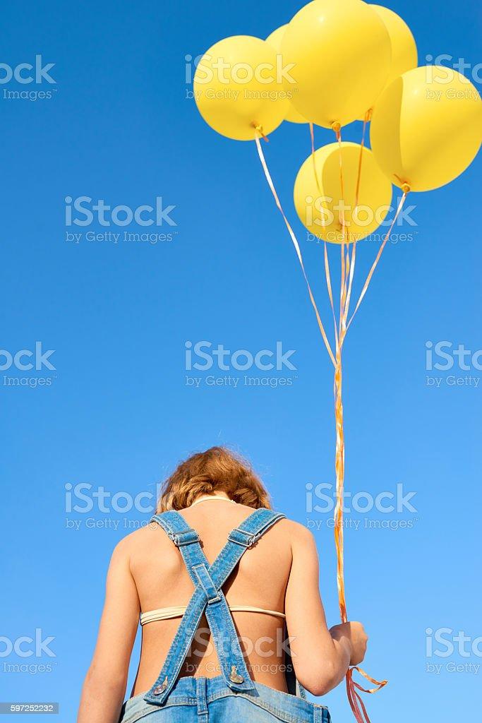 Sad Kid with Balloons stock photo
