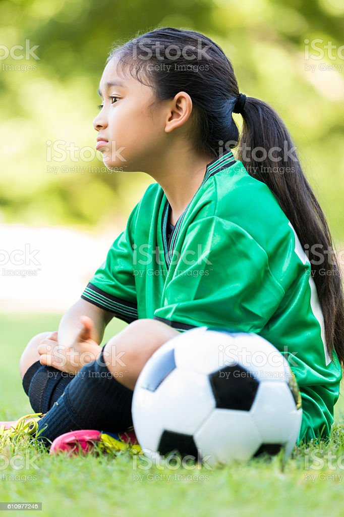 Sad little girl after soccer game stock photo