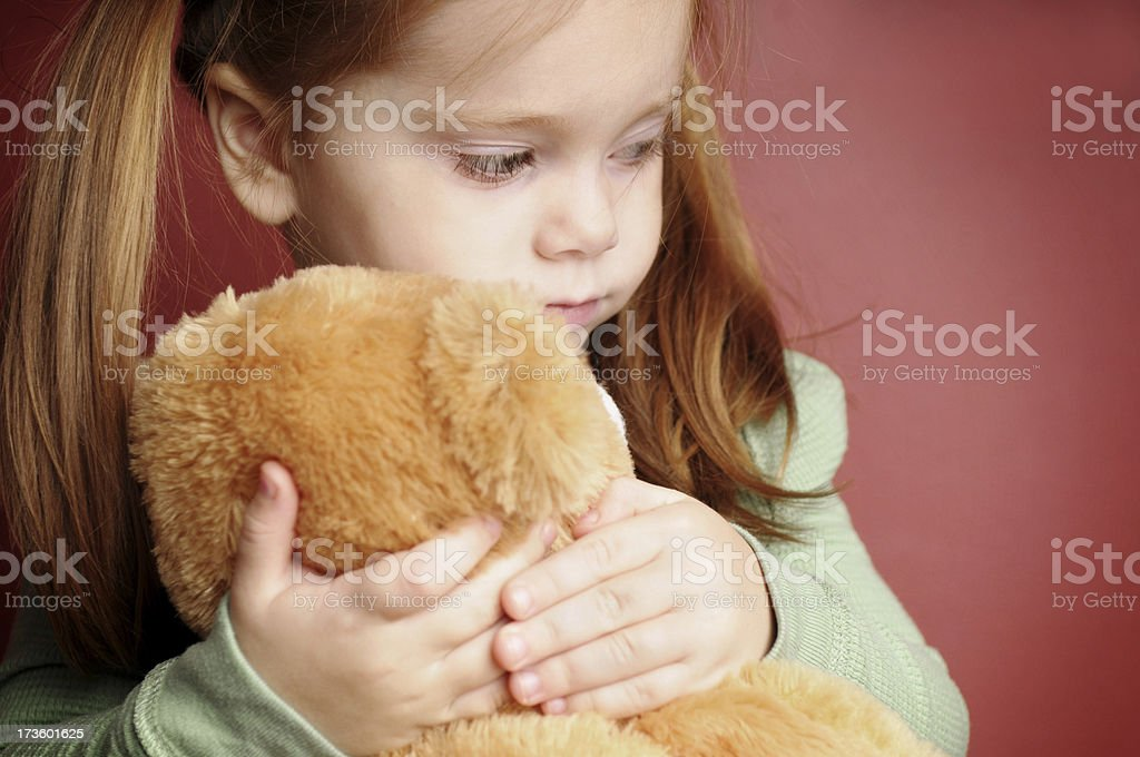 Sad Little Girl Holding Her Teddy Bear royalty-free stock photo