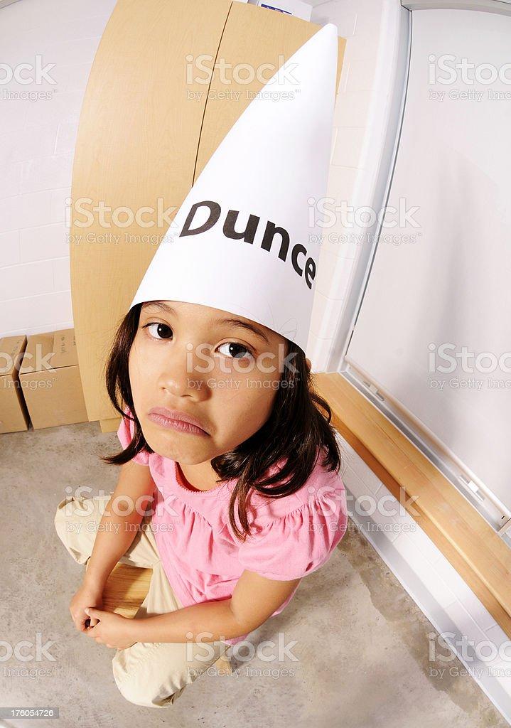Sad Little Girl in Dunce Cap royalty-free stock photo