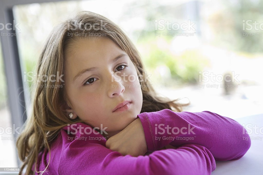 Sad little girl with head rested on hands royalty-free stock photo