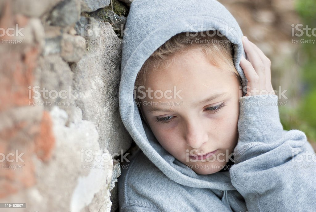 Sad little girl with hoodie jacket royalty-free stock photo