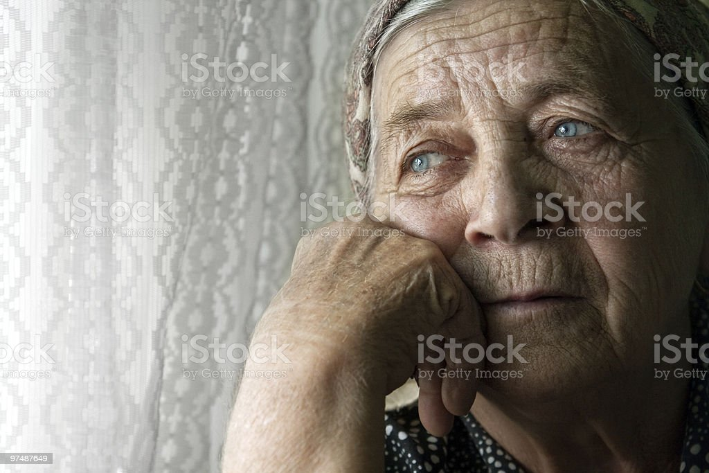 Sad lonely pensive old senior woman royalty-free stock photo