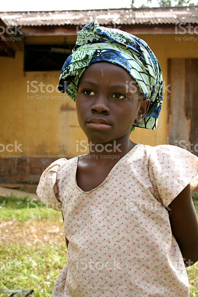 Sad looking African girl wearing something on her head stock photo