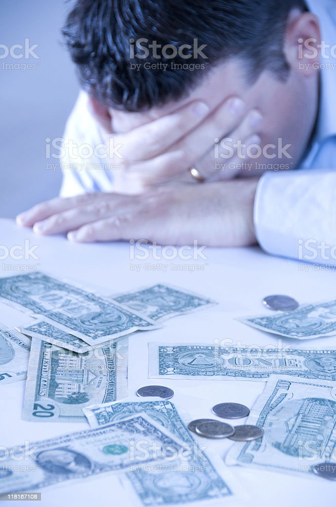 Sad man has economic trouble and not enough money royalty-free stock photo