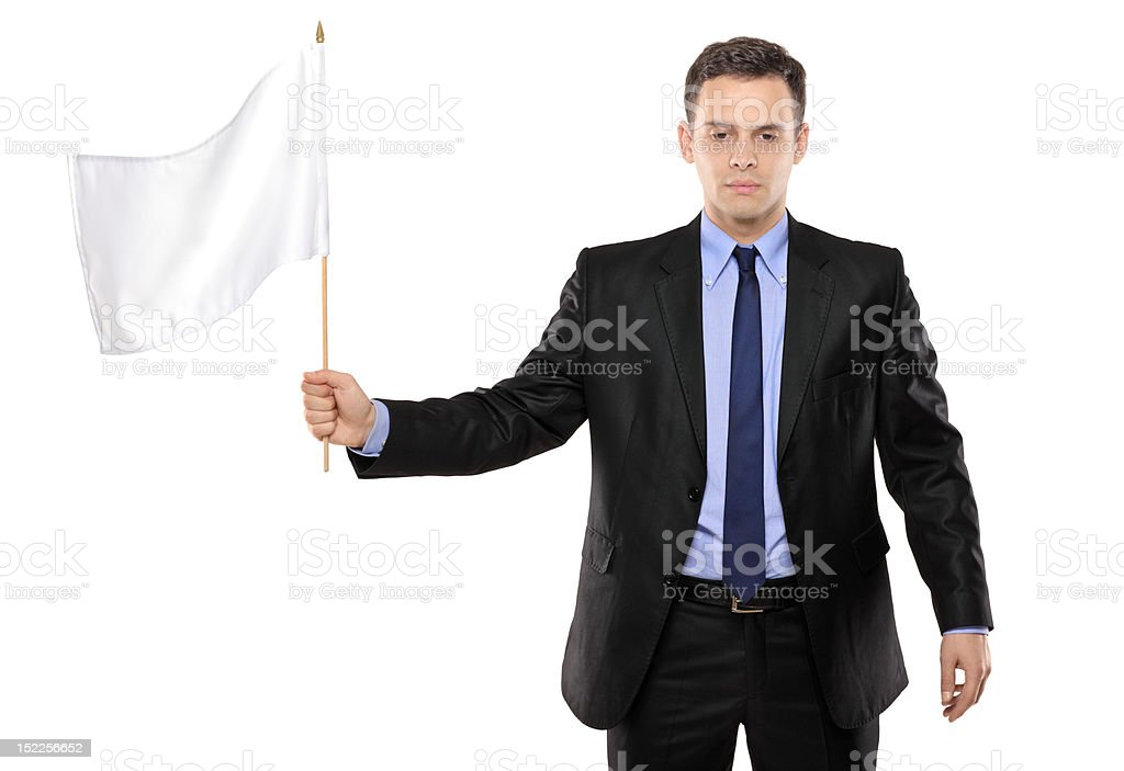 Sad man holding a white flag gesturing defeat royalty-free stock photo