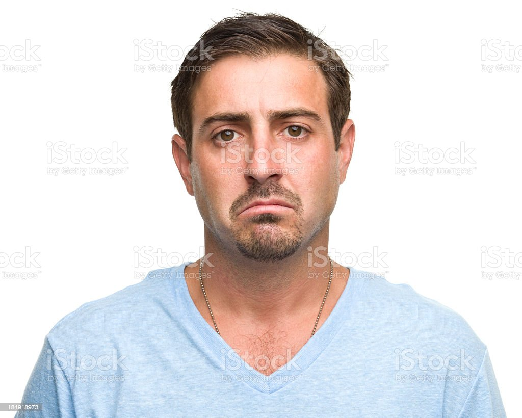 Sad man in a light blue T-shirt on a white background stock photo