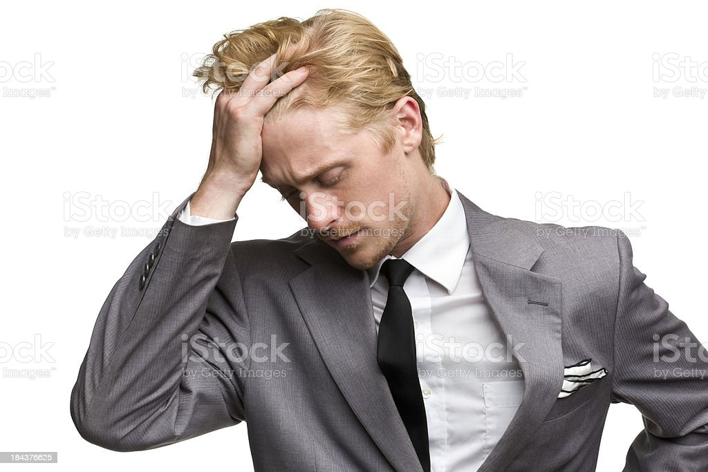 Sad Man In Suit Rubs Forehead royalty-free stock photo