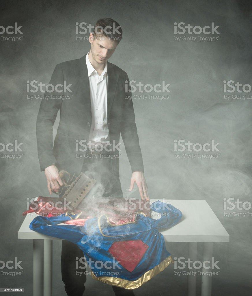 sad man ironing heroes uniform stock photo