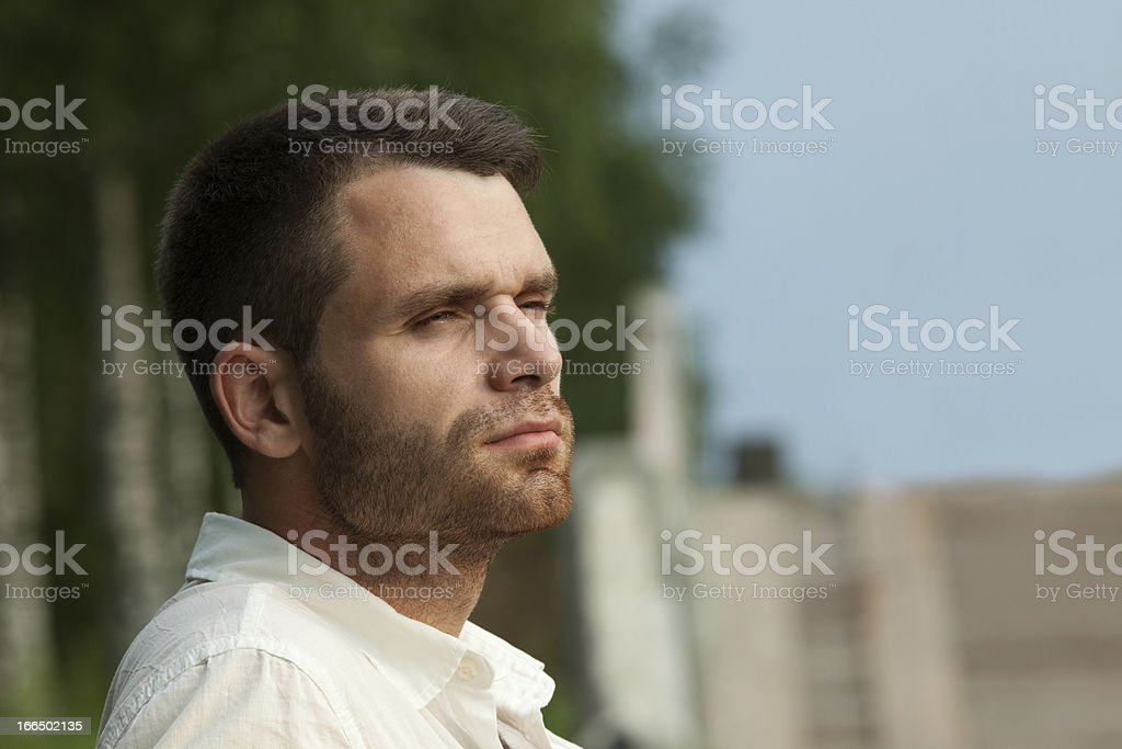 Sad man portrait in summer park look at sunset royalty-free stock photo