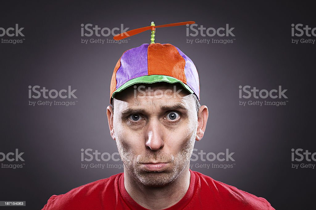 Sad man wearing a propeller beanie stock photo