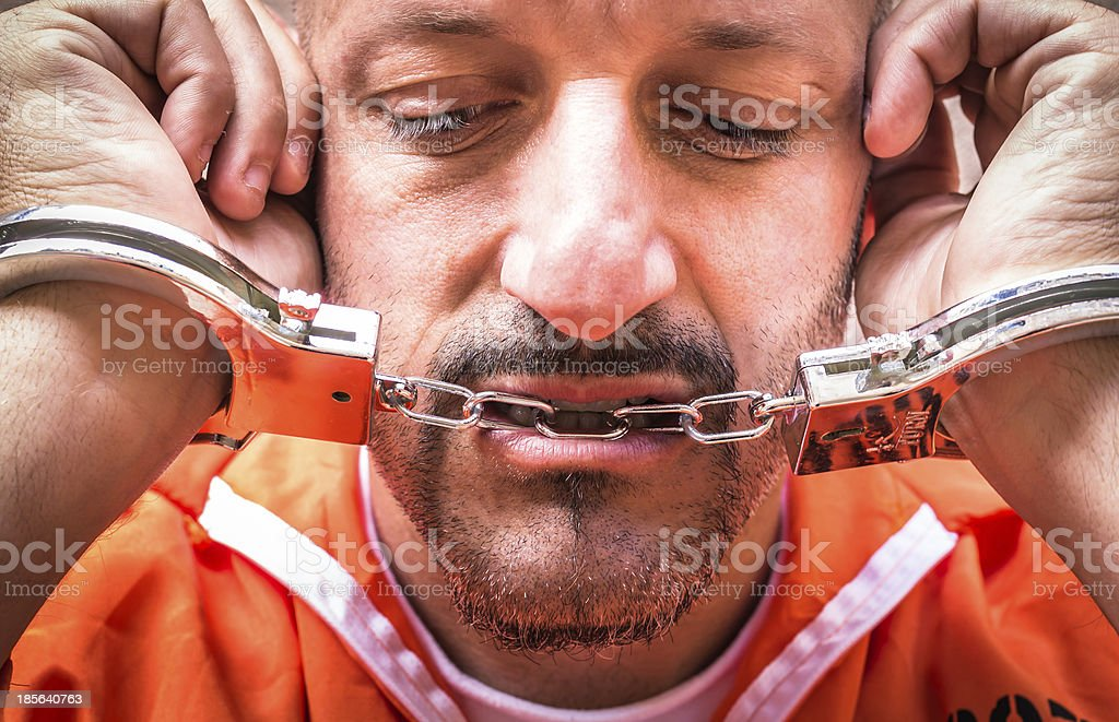 Sad Man with Handcuffs in Prison stock photo