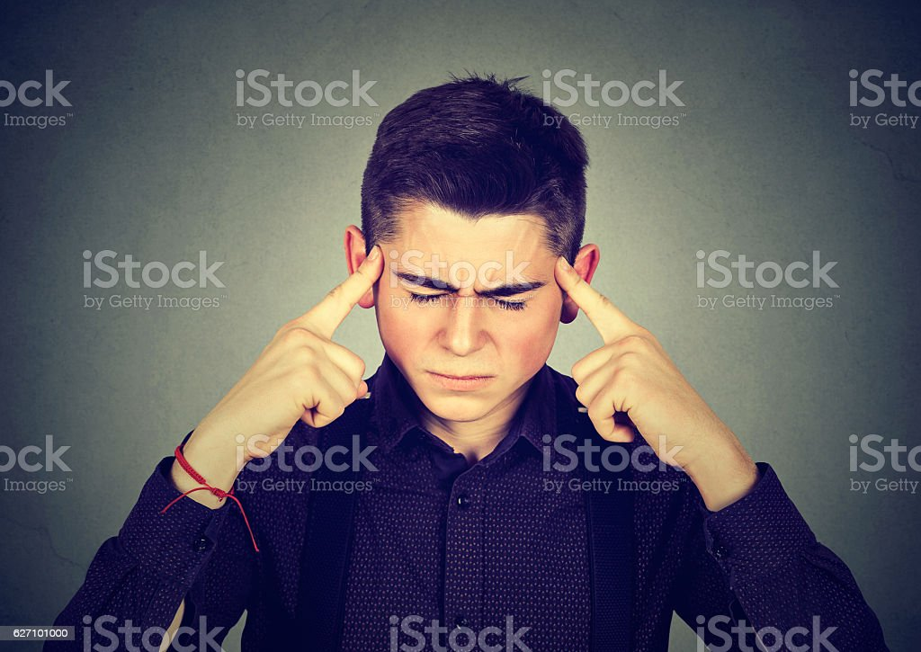 sad man with worried stressed face expression looking down stock photo