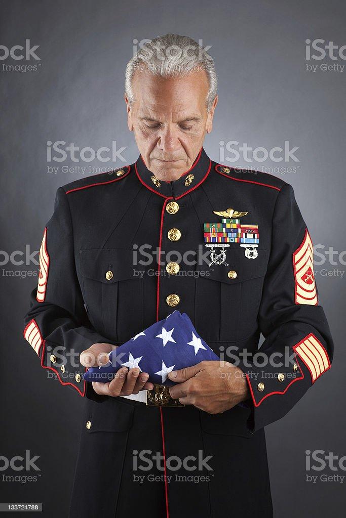 Sad Marine Holding a flag royalty-free stock photo