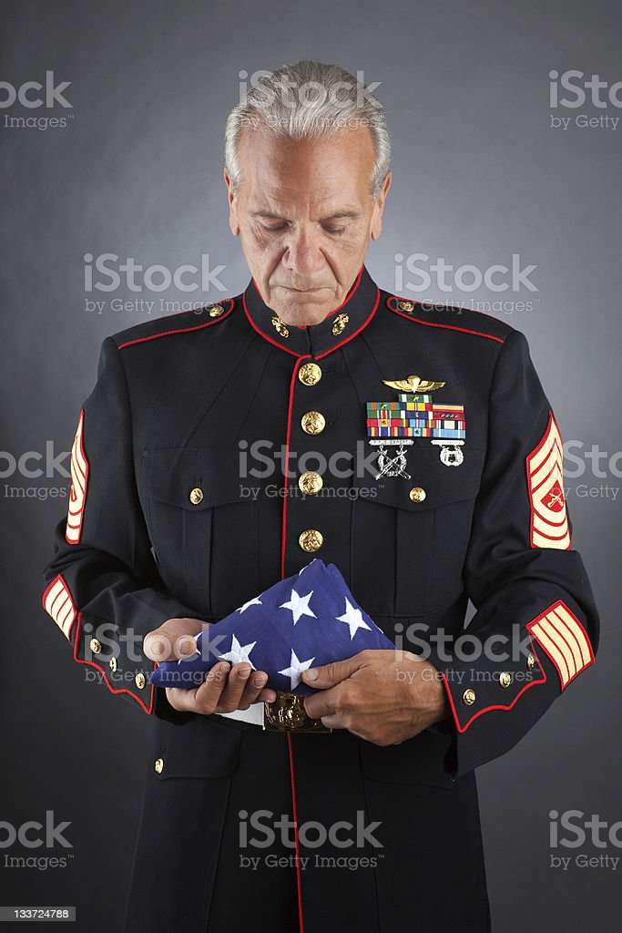 Sad Marine Holding a flag stock photo