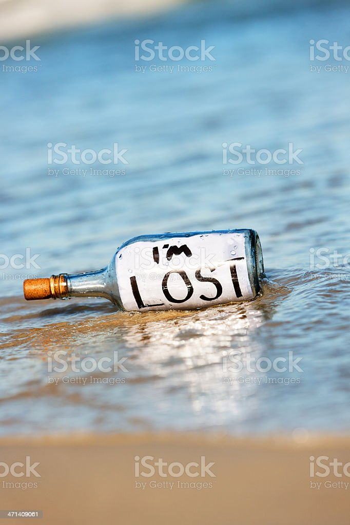 Sad message  in bottle on beach says I'm lost stock photo