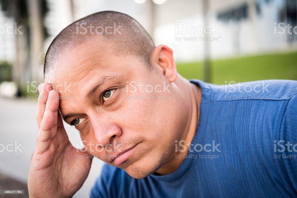 Sad mid adult man stock photo