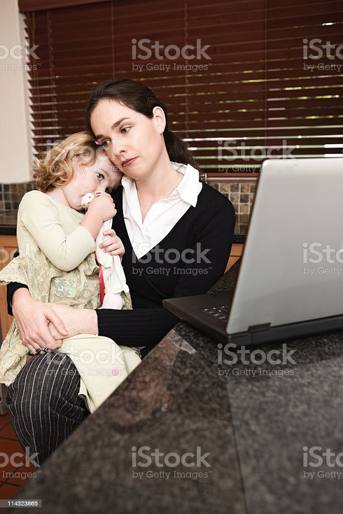Sad mom and daughter with laptop computer royalty-free stock photo