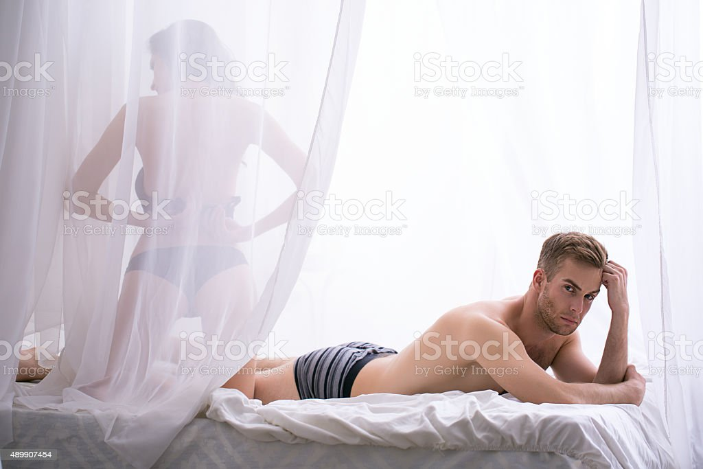 Sad morning in the bedroom of a young couple stock photo