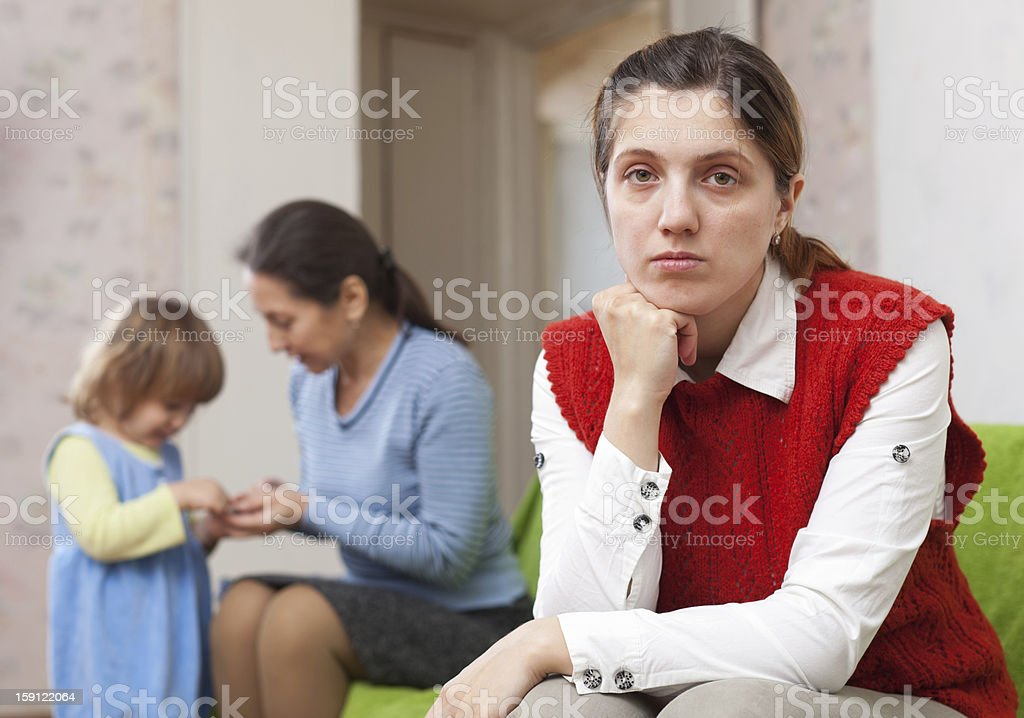 Sad mother against grandmother royalty-free stock photo
