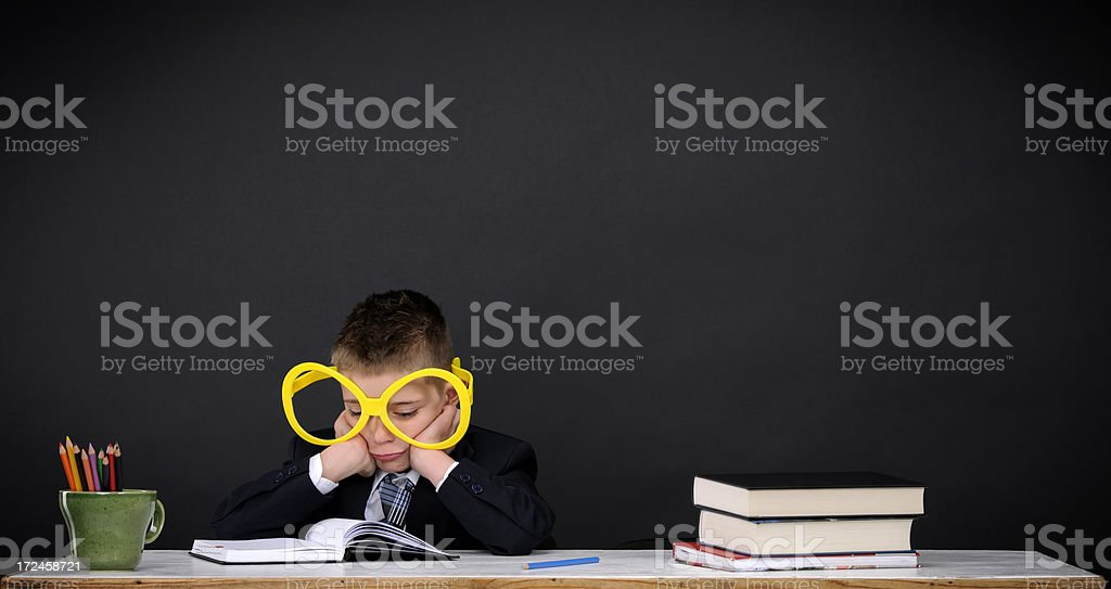 sad nerd trying to learn royalty-free stock photo