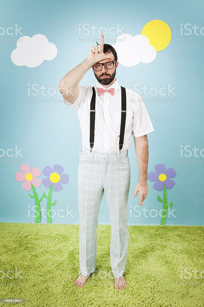 Sad, Nerdy Man Frowning While Making 'L' on Forehead royalty-free stock photo