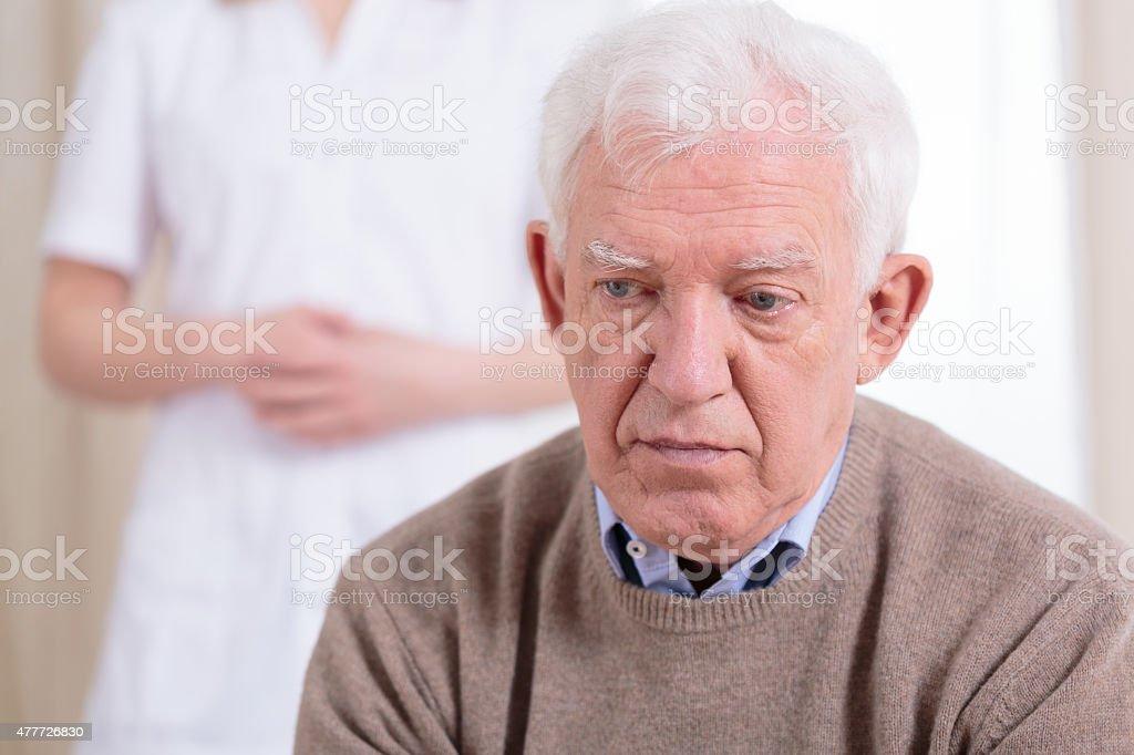 Sad older man stock photo