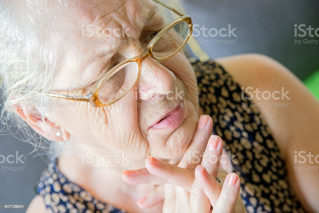 Sad Older woman worried about the future stock photo