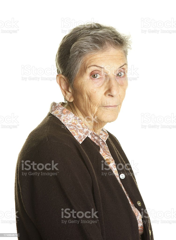 Sad or Lonely Elderly Woman on White Background royalty-free stock photo