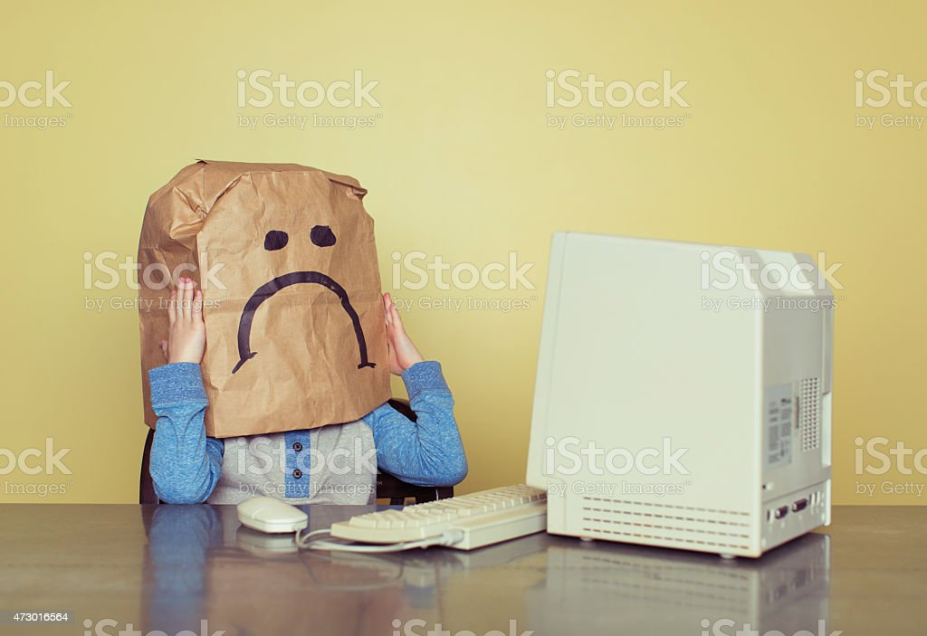 Sad Paper Bag Boy is Cyber Bullying Victim stock photo