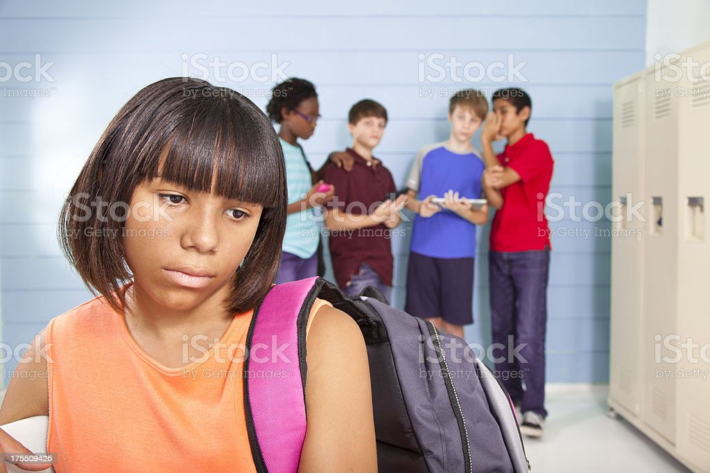 Sad Pre-teen girl being bullied by classmates royalty-free stock photo